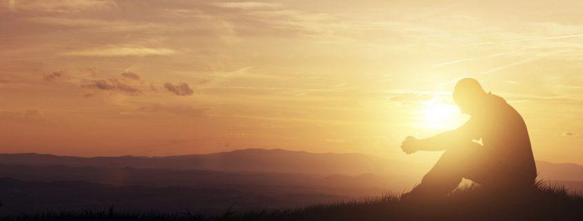 Man Praying Sunset